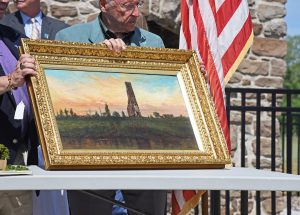 Buffalo State's world-renowned painting-restoration program recently brought this more than 100-year-old depiction of The Old Stone Chimney back to life, cleaning the paint and repairing two tears in the canvas. It was unveiled to the public for the first time at Monday's rededication ceremony.